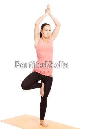 yoga exercise on the mat vrikshasana