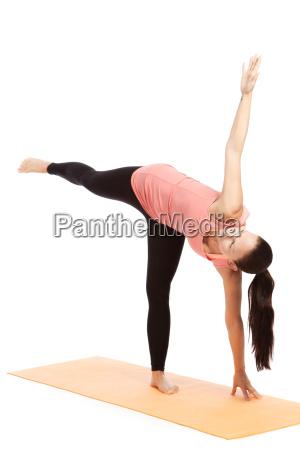 yoga exercise on the mat ardha