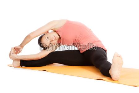 yoga exercise on the mat parivrtta