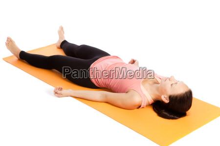 yoga exercise on the mat shavasana