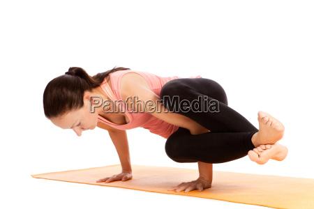 yoga exercise on the mat kakasana
