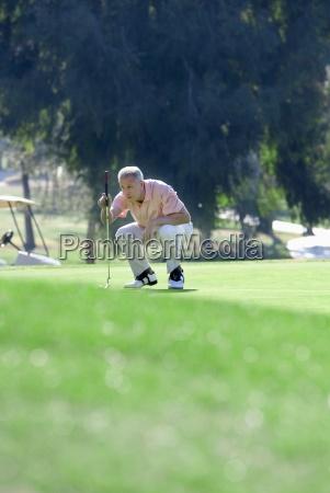 mature man lining up putting shot