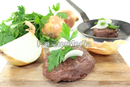ostrich steaks with onions and parsley