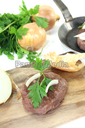 ostrich steaks with smooth parsley on