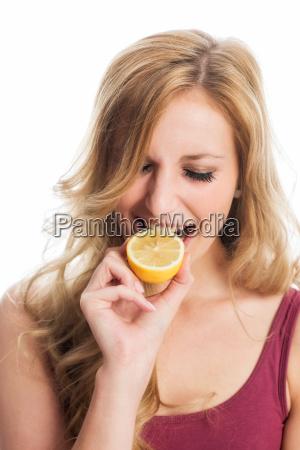 woman bite in lemon