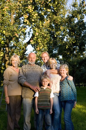 family of three generations arm in