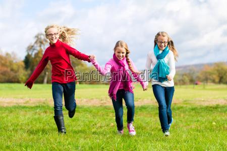 girl running through autumn park