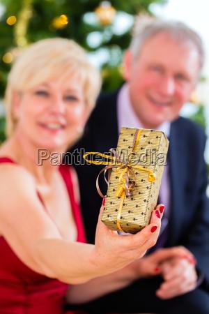 pensioner couple celebrates christmas eve