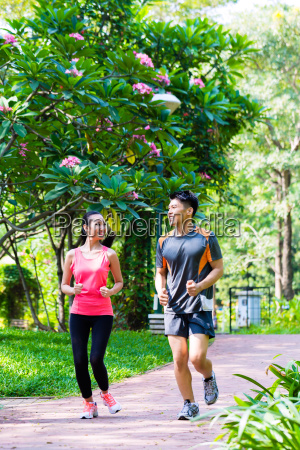 asian chinese man and woman jogging