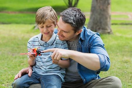 boy with toy aeroplane sitting on