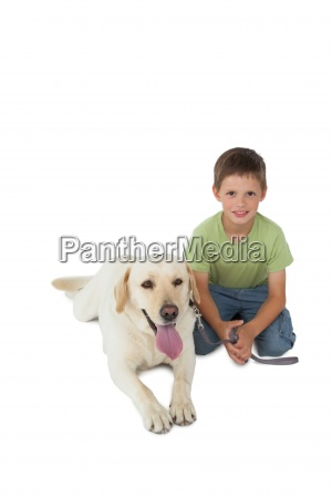 cute little boy kneeling with his