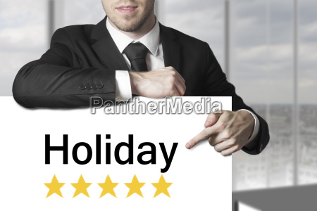 businessman pointing on sign holiday rating