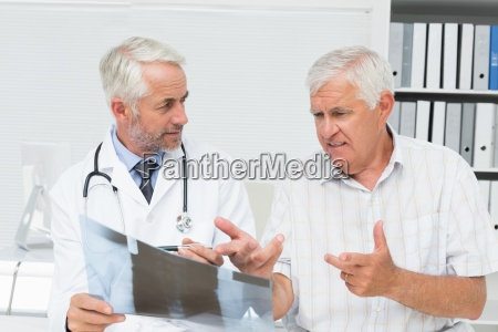 male doctor explaining x ray report