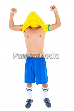 football player in yellow celebrating a