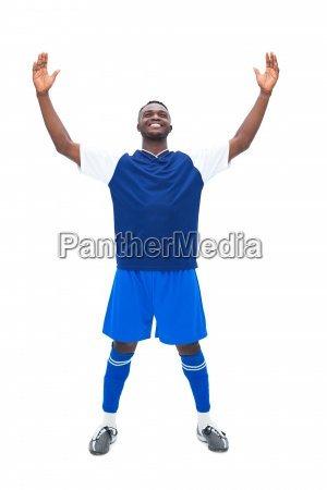 football player in blue celebrating a