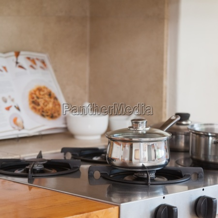 stove top with saucepan and recipe