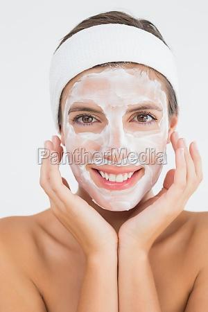 attractive woman having white cream on