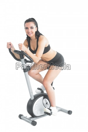 beautiful ponytailed woman using her exercise