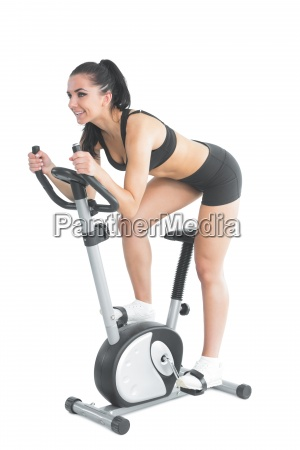 active ponytailed woman training on an