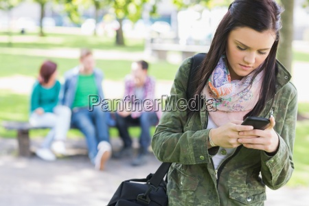 college girl text messaging with blurred
