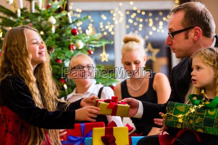family on christmas eve with christmas