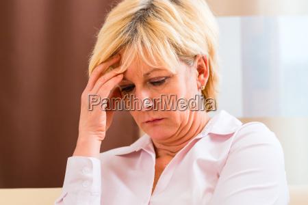 senior summarizes with headache at the