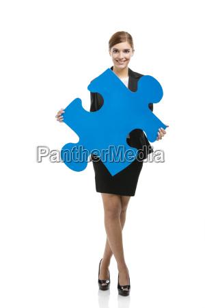 business woman holding a blue arrow