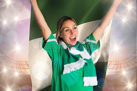 cheering football fan in green jersey
