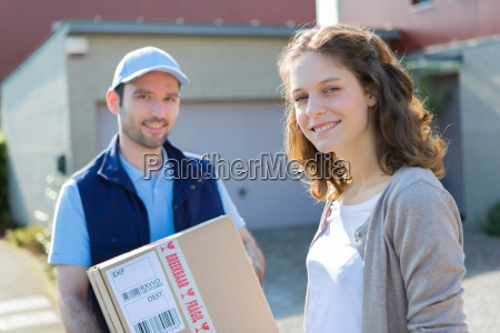young attractive delivery man on his