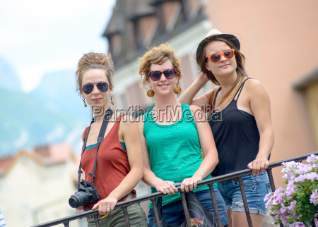 three young women make tourism in