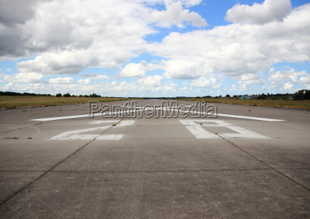 airplane runway asphalt with number and