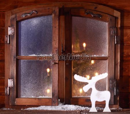 reindeer decoration on a rustic windowsill