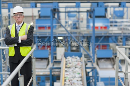 portrait of serious businessman standing on