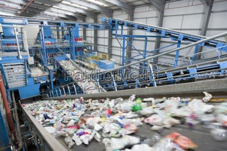 plastic moving along conveyor belt in