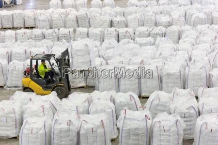 forklift operator lifting large bag of