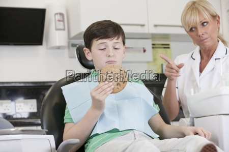a young boy at the dentist