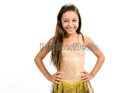 teenger smiling in golden dress posing