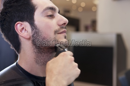 a male client having his facial