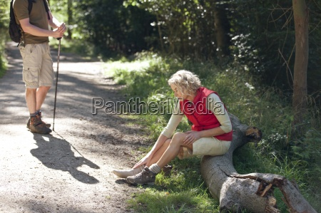 a mature couple resting beside a