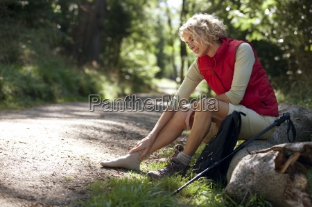 a mature woman resting beside a