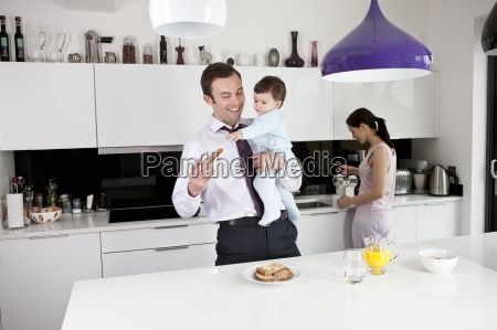 a father trying to eat his