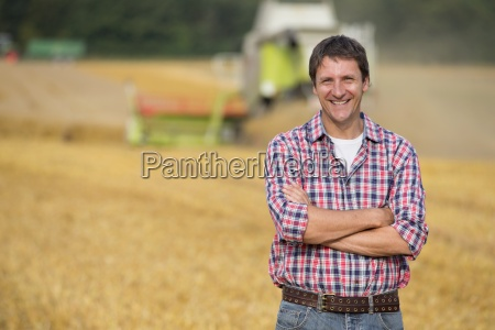 farmer in field as oat crop