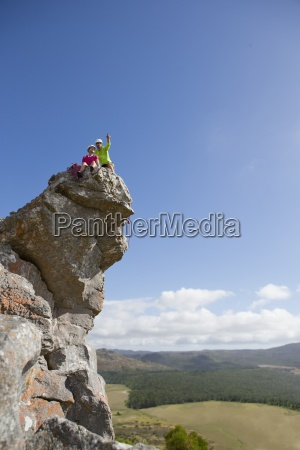 rock climbers pointing and looking at