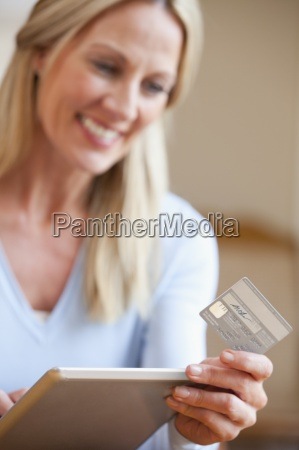 close up of woman holding credit