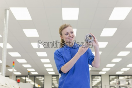 portrait of smiling engineer holding gear