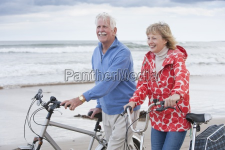 mature couple riding cycles on winter