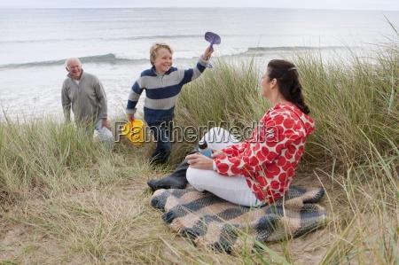 grandparents and grandson having picnic in