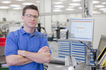 portrait of technician with arms crossed