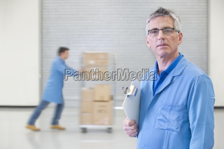 portrait of serious worker with clipboard