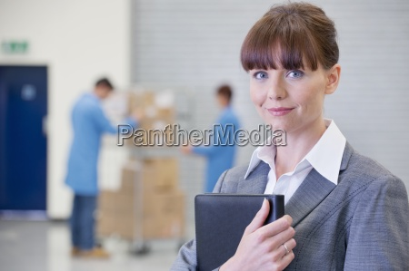 portrait of smiling businesswoman in warehouse